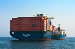 Bunkering tanker Russian Island container ship Hyundai company. Nakhodka Bay. East (Japan) Sea. 19.04.2014 Stock Photos