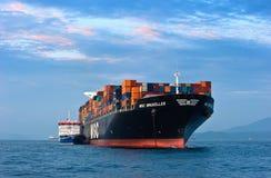 Bunkering tanker Zaliv America container ship MSC Bruxelles. Nakhodka Bay. East (Japan) Sea. 05.08.2015 Stock Photography