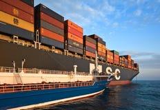 Bunkering tanker Zaliv America container ship MSC Bruxelles. Nakhodka Bay. East (Japan) Sea. 05.08.2015 Royalty Free Stock Image