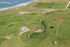 Bunkers and North Sea in Hirtshals, Denmark. View from the top of the lighthouse in Hirtshals, Denmark. Green Meadow, old German bunkers from the Second world Royalty Free Stock Images
