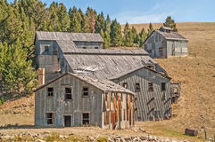 Bunkhouse, Flotation Mill, and more. Bunkhouse, flotation mill, and other buildings sit abandoned in a Montana ghost town stock images