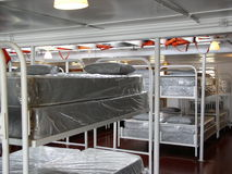 Bunks for steamship Crew. Steamship crew quarters are cramped and stuffy. Each person has a small area to sleep and a locker to place personal items. At sea life stock photo