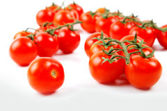 Bunnch of cherry tomatoes  on a white Royalty Free Stock Photography