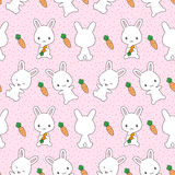 Bunnies with carrots seamless pattern. Cute kawaii bunnies with carrots seamless pattern Stock Photography