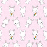 Bunnies with carrots seamless pattern Royalty Free Stock Photos