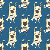 Bunnies cartoon seamless pattern, hand drawing, vector background. Funny painted yellow rabbit with a carrot in the paws on a blue Stock Images