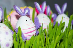 Bunnies with colored eggs Stock Photography