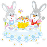 Bunnies with an Easter cake Royalty Free Stock Photo