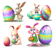 Bunnies with Easter eggs Stock Photography