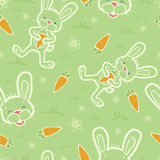 Bunnies eating carrots seamless pattern background Stock Photography