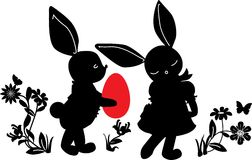 Bunnies with egg gift. Silhouettes Royalty Free Stock Image