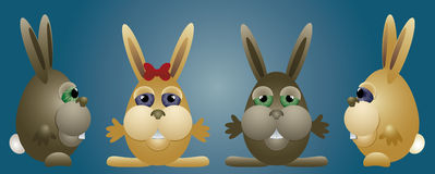Bunnies family. Four bunnies, front and side - on a blue background as an Easter banner Royalty Free Stock Image