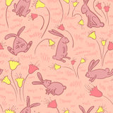 Bunnies and flowers Stock Photos