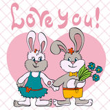 Bunnies love girl and boy Royalty Free Stock Image