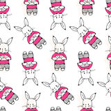 Bunnies. Seamless pattern with funny cartoon Bunnies. Hand-drawn illustration. Vector stock illustration