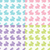 Bunnies Silhouettes. A set of four seamless vector pattern with easter bunnies colourful silhouettes  on the dotted background Stock Photos