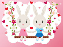 Bunnies on a swing vector card Royalty Free Stock Photography