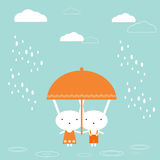 Bunnies with umbrella Royalty Free Stock Images