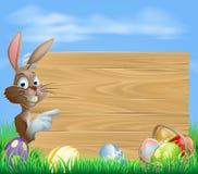 Bunny και αυγά Πάσχας με το ξύλινο σημάδι διανυσματική απεικόνιση