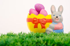 Bunny basket. Bunny shaped basket filled with pink easter eggs Stock Photos