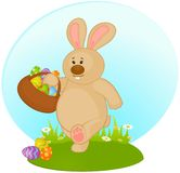 Bunny with basket and colored eggs Stock Images