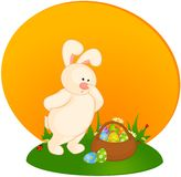Bunny with basket and colored eggs Stock Photography