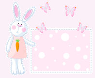 Bunny Card. Cute bunny pointing on the greeting card Stock Photography