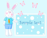 Bunny Card. Cute bunny pointing on the greeting card Royalty Free Stock Photo