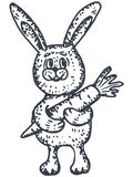 Bunny with carrot Stock Images