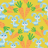 Bunny and carrots. Yellow background. Royalty Free Stock Images