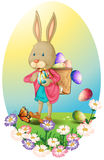 A bunny carrying a bag of Easter eggs Stock Image