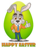 Bunny cartoon character. Happy Easter greeting card. Cute rabbit showing thumb up, green egg on background. Stock Images
