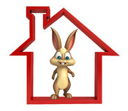 Bunny cartoon character with home sign Royalty Free Stock Photography