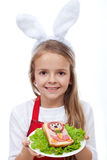 Bunny chef presenting her masterpiece - a rabbit shaped sandwich Stock Images