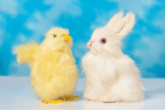 Bunny and chick on a blue sky background . Stock Photos