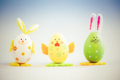 Bunny and chicken shaped painted easter eggs Stock Photos