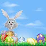 Bunny and chocolate Easter eggs Stock Photography