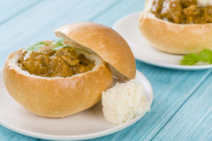 Bunny Chow. South African mutton curry served inside a hollow bread bun Stock Photography