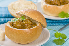 Bunny Chow. South African mutton curry served inside a hollow bread bun Royalty Free Stock Photos