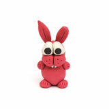 Bunny, clay modeling. A pink rabbit made from clay Royalty Free Stock Images
