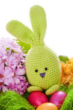 Bunny with colorful flowers and easter eggs Stock Image
