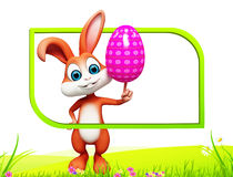 Bunny with colouring egg. Easter happy smart bunny with colouring egg Stock Image
