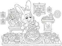 Bunny cooking an Easter cake. Little Easter rabbit decorating a fancy pie to the holiday, a black and white vector illustration in funny cartoon style for a Stock Photo