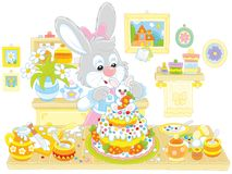 Bunny cooking an Easter cake. Little Easter rabbit decorating a fancy pie to the holiday, a vector illustration in funny cartoon style Royalty Free Stock Photography