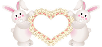 Bunny couple holding embroidered heart Royalty Free Stock Image