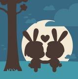 Bunny Couple Kissing Under Tree Photo stock
