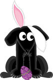 Bunny Dog. Black dog looking up at bunny ear hanging in his face - easter egg at his feet vector illustration