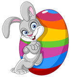 Bunny with easter egg. Happy bunny leaned against a big Easter egg vector illustration