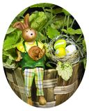 Bunny with easter eggs with a plant in backgroun Royalty Free Stock Photography