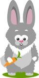 Bunny And en morot som isoleras över vit bakgrund Arkivfoton